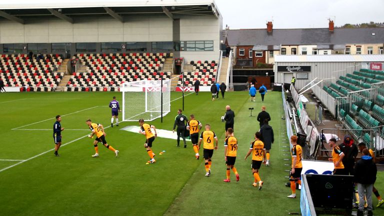 Newport County players enter the pitch for their Carabao Cup tie against Newcastle United at Rodney Parade