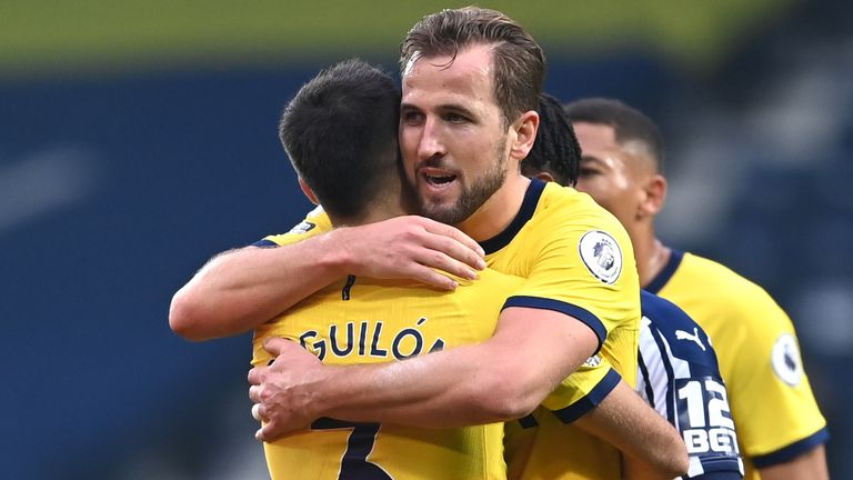 Harry Kane celebrates Spurs' win over West Brom with Sergio Reguilon