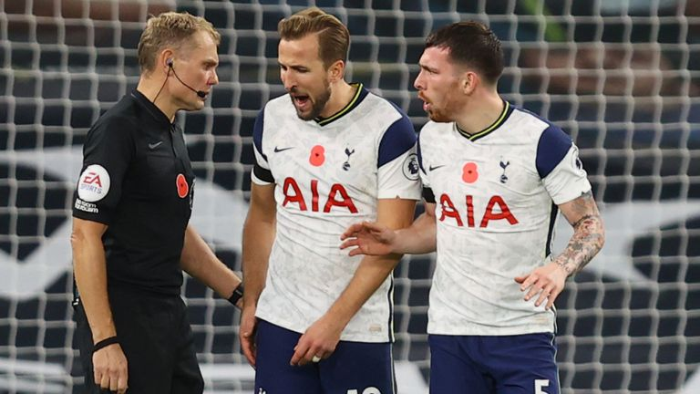 Harry Kane and Pierre-Emile Hojbjerg speak to referee Graham Scott,after Brighton's equaliser
