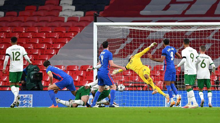 Harry Maguire watches his header flash beyond Darren Randolph