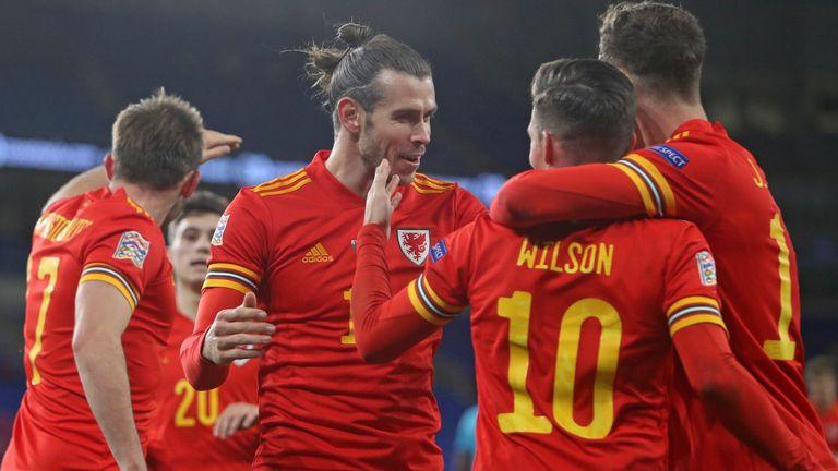 Harry Wilson celebrates scoring against Finland with Gareth Bale