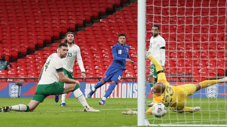 Sancho's precise shot finds the bottom corner to stretch England's lead