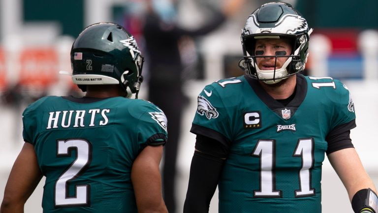 Jalen Hurts (L) is 'expected to receive 'increased playing time' in relief of starting quarterback Carson Wentz (R) on Monday night