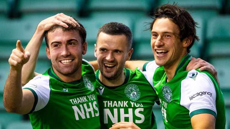 Jamie Murphy celebrates with Steven Mallan and Joe Newell celebrate Hibernian's opener