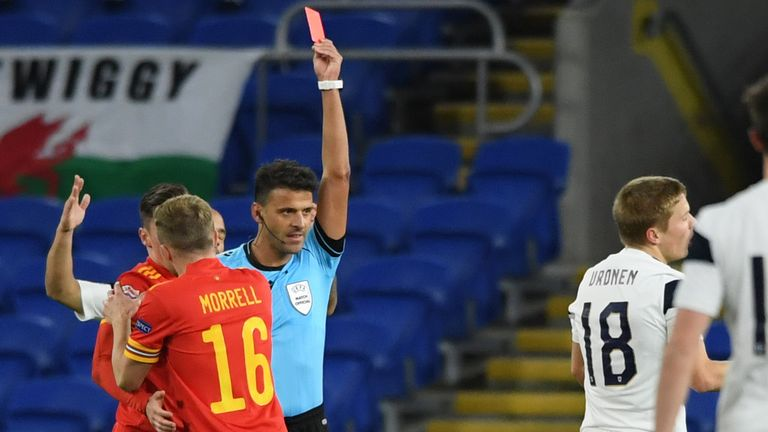 Jere Uronen of Finland receives a red card from referee, Jesus Gil Manzano against Wales