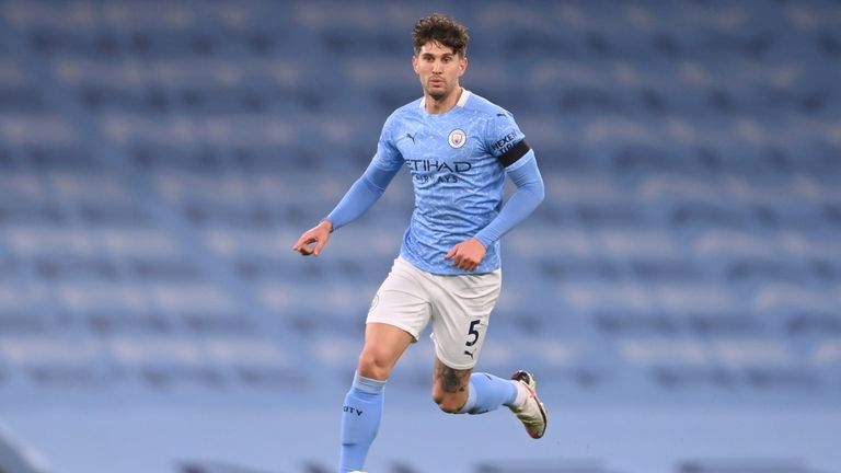 Manchester City's English defender John Stones runs with the ball during the English Premier League football match between Manchester City and Burnley at the Etihad Stadium in Manchester, north west England, on November 28, 2020
