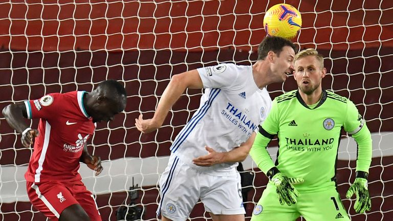 Jonny Evans scores an own goal under pressure from Sadio Mane