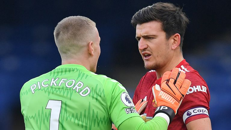 Jordan Pickford and Harry Maguire have words after the Everton goalkeeper kicked the Manchester United captain but avoided VAR action