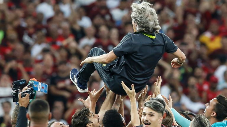 RIO DE JANEIRO, BRAZIL - NOVEMBER 27: Players of Flamengo hold the coach Jorge Jesus after winning the Brasileirao 2019 after the match against Cear.. at Maracana Stadium on November 27, 2019 in Rio de Janeiro, Brazil.
