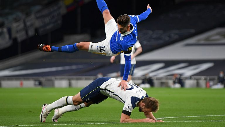 Tottenham were awarded a penalty against Brighton when Adam Lallana went up for a header and Harry Kane went to ground under pressure from the midfielder