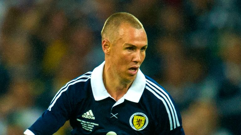 Goalscorer Kenny Miller in action for Scotland in their 3-2 friendly defeat to England at Wembley in 2013
