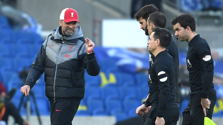 Klopp talks to the officials after their 1-1 draw with Brighton.