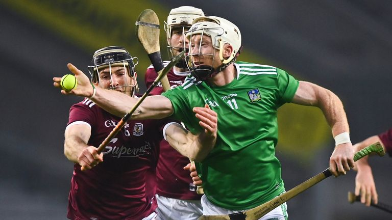 Cian Lynch of Limerick in action against Padraic Mannion of Galway