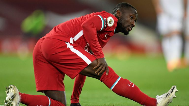 Liverpool's Guinean midfielder Naby Keita leaves the pitch injured during the English Premier League football match between Liverpool and Leicester City at Anfield in Liverpool, north west England on November 22, 2020