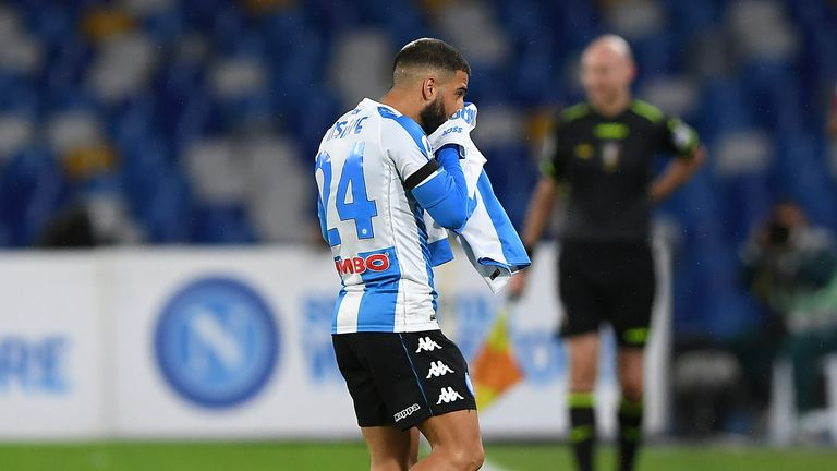 Napoli's Lorenzo Insigne kisses a commemorative shirt for former player Diego Maradona