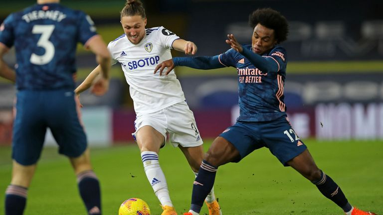 Luke Ayling and Willian compete for possession early in the first half