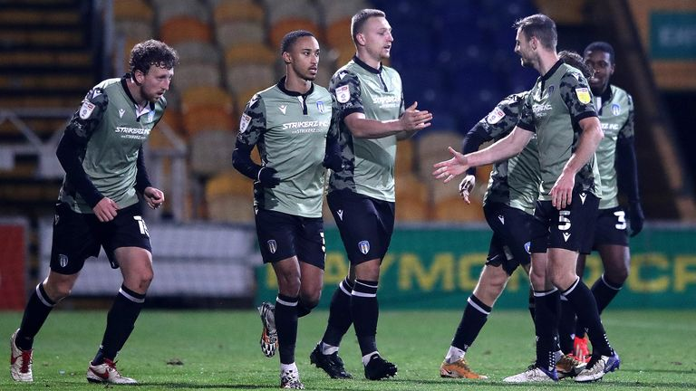 Luke Norris rescued Colchester a point at Mansfield in the final five minutes