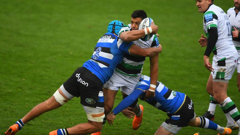Luther Burrell of Newcastle Falcons is tackled by Zach Mercer of Bath