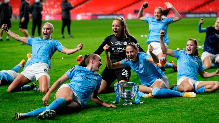 City players celebrate their extra-time win at Wembley