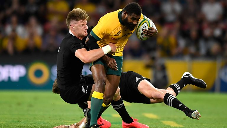 Marika Koroibete is wrapped up by the All Blacks defence
