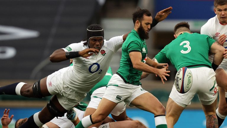 Itoje (L) tackles Ireland's scrum-half James Gibson-Park
