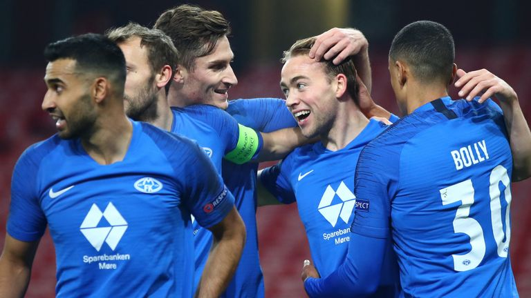 Molde players celebrate after Martin Ellingsen put them ahead at Arsenal