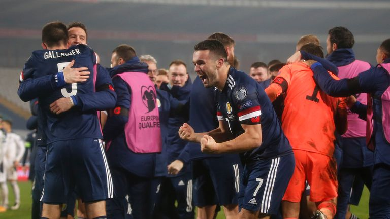 John McGinn celebrates Scotland's qualification to Euro 2020