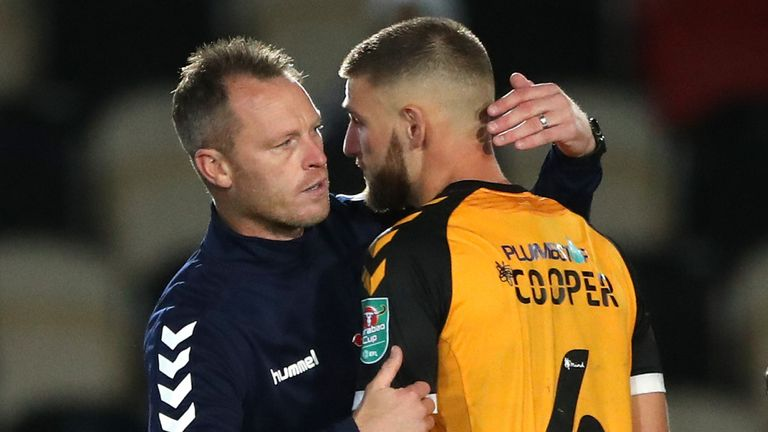 Michael Flynn consoles his players after their penalty shootout defeat to Newcastle in the Carabao Cup fourth round