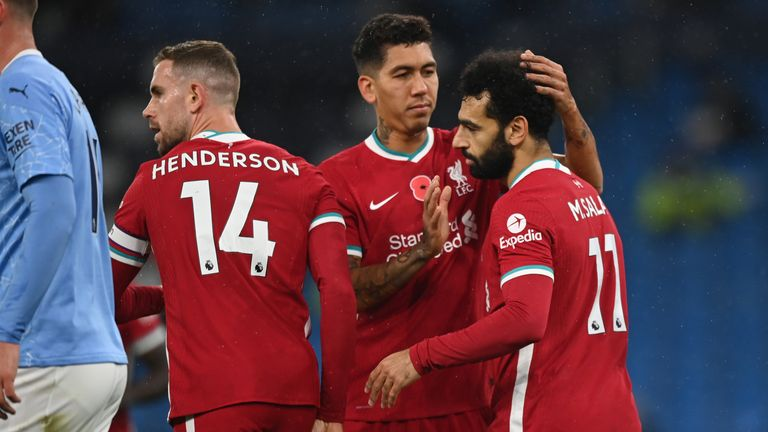 Mohamed Salah celebrates with team-mates Roberto Firmino and Jordan Henderson after giving Liverpool the lead