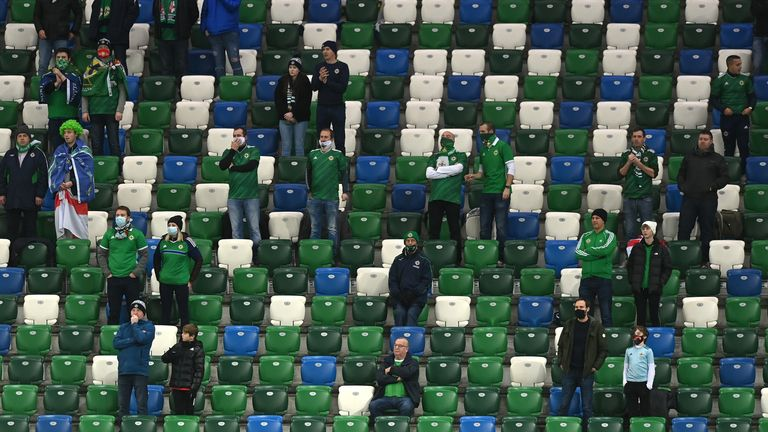 Fans look on from the stands socially distanced during the UEFA EURO 2020 Play-Off Final between Northern Ireland and Slovakia at Windsor Park on November 12, 2020 in Belfast, Northern Ireland.