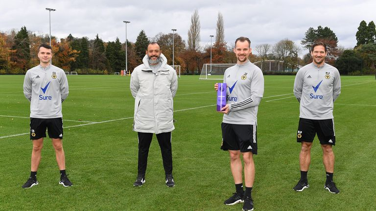 Nuno Espirito Santo accepts the October manager of the month award alongside his coaching staff
