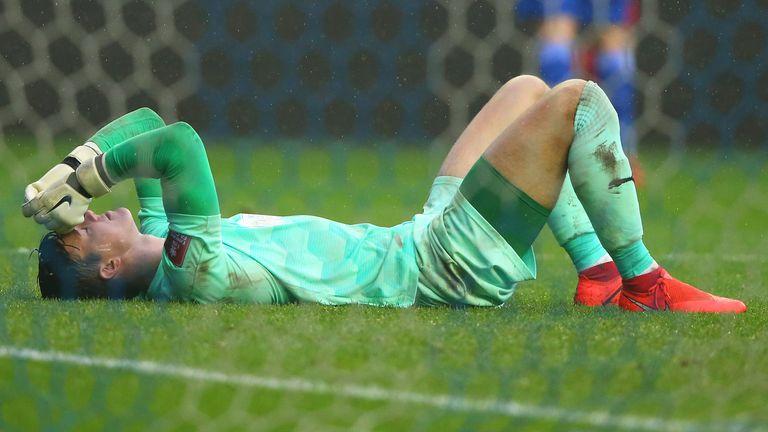 Wigan goalkeeper Owen Evans reacts after losing to Chorley