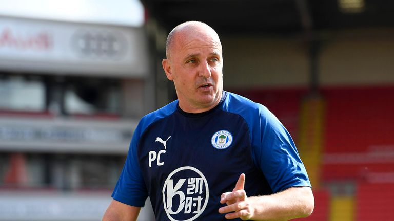 Paul Cook, Manager of Wigan Athletic reacts following the Sky Bet Championship match between Barnsley and Wigan Athletic at Oakwell Stadium on July 11, 2020 in Barnsley, England. Football Stadiums around Europe remain empty due to the Coronavirus Pandemic as Government social distancing laws prohibit fans inside venues resulting in all fixtures being played behind closed doors