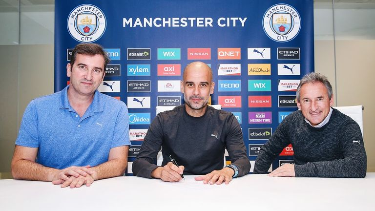 Pep Guardiola (cente) has signed a new deal until 2023