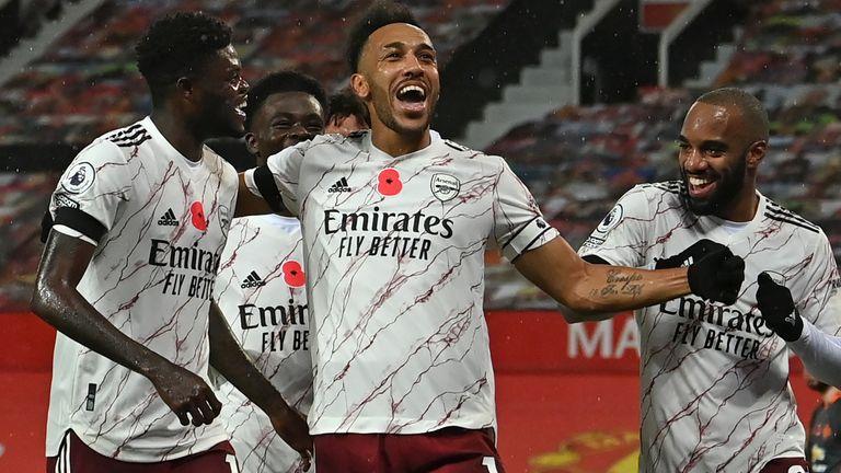 Pierre-Emerick Aubameyang (C) celebrates with teammates after scoring for Arsenal at Man Utd