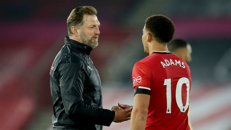 Ralph Hasenhuttl shakes hands with Adams at the final whistle