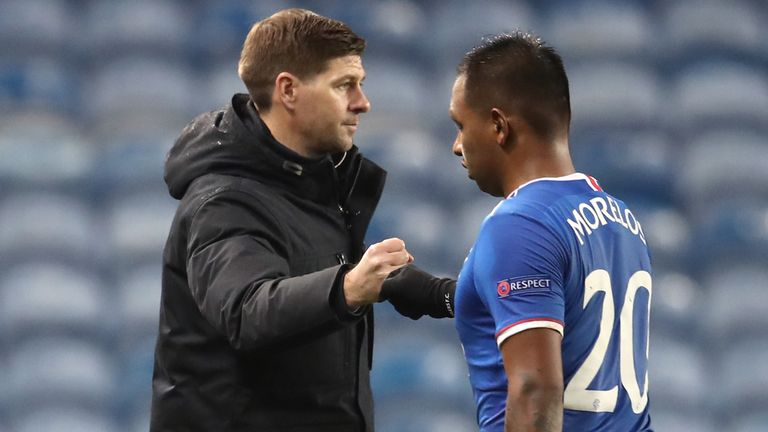Rangers manager Steven Gerrard fist bumps Alfredo Morelos after the draw with Benfica
