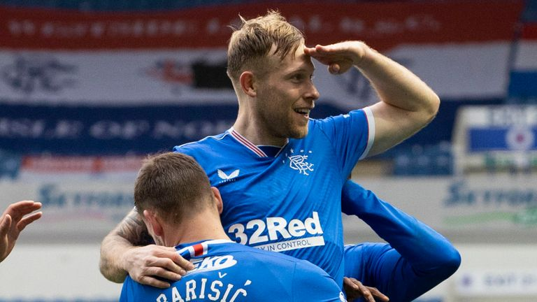 Rangers' Scott Arfield (centre) celebrates with Borna Barisic after making it 3-0 during a Scottish Premiership match between Rangers and Aberdeen at Ibrox