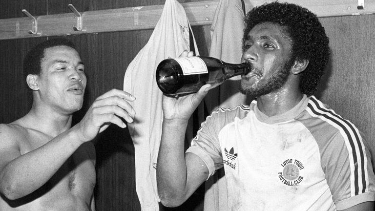 Luton Town returned to the First Division when they beat Shrewsbury Town 4-1. Celebrating after the game with champagne is Brian Stein (left) and Ricky Hill.