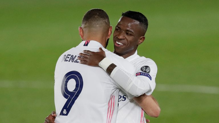 Rodrygo celebrates at the final whistle after meeting Vinicius' pass