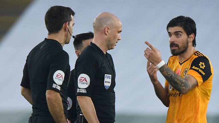 Ruben Neves voices his disapproval at referee Anthony Taylor on Sunday