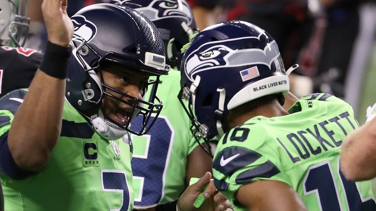 Wilson and Tyler Lockett celebrate after linking up for a touchdown in the second quarter
