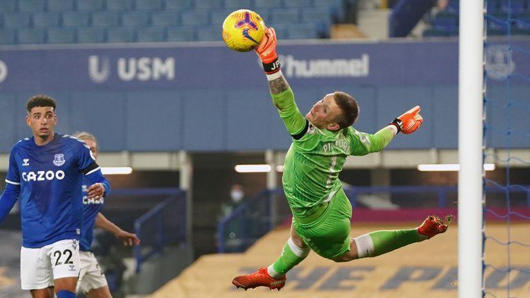 Everton goalkeeper Jordan Pickford saves a shot from Leeds United's Raphinha