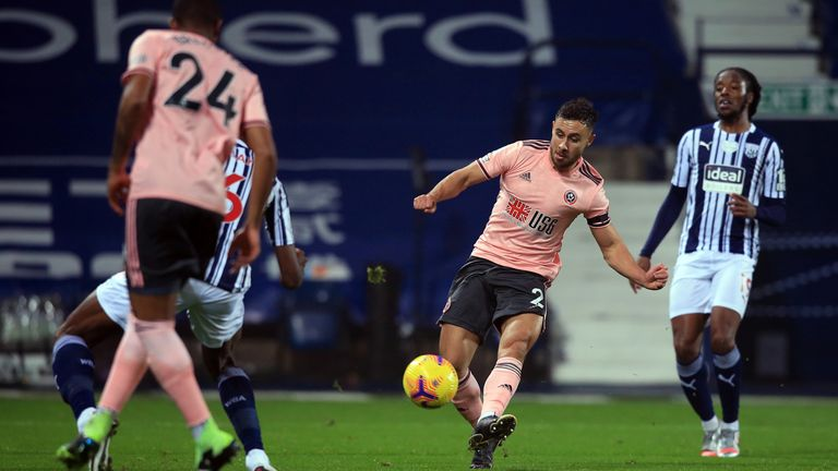 Sheffield United's George Baldock shoots over against West Brom