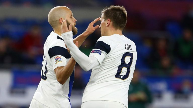 Teemu Pukki celebrates with Finland's midfielder Robin Lod after scoring against Wales