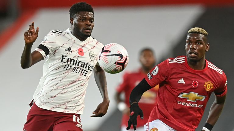 Thomas Partey and Paul Pogba in Premier League action at Old Trafford