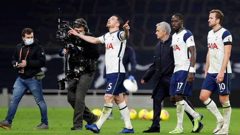 Jose Mourinho and his Spurs players celebrate the victory