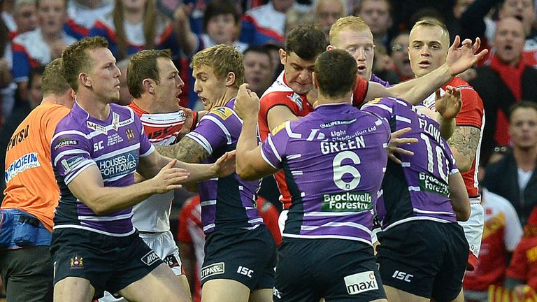 Wigan Warriors Ben Flower fights with St Helens Paul Wellens before being given a red card during the First Utility Super League Grand Final match at Old Trafford, Manchester. PRESS ASSOCIATION Photo. Picture date: Saturday October 11, 2014. See PA story RUGBYL Super. Photo credit should read Martin Rickett/PA Wire. RESTRICTIONS: Editorial use only. No commercial use. No false commercial association. No video emulation. No manipulation of images