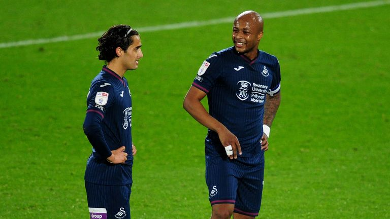 Yan Dhanda of Swansea City speaks with team mate Andr.. Ayew during the Sky Bet Championship match between Brentford and Swansea City at the Brentford Community Stadium on November 03, 2020 in Brentford, England. (Photo by Athena Pictures/Getty Images)