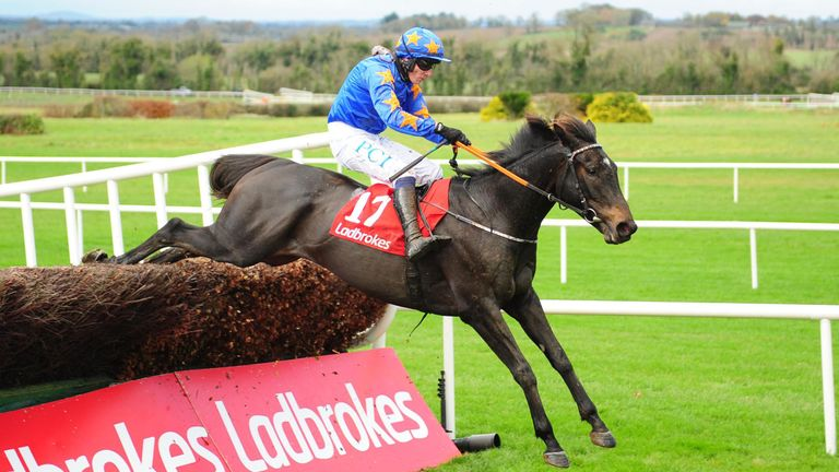 The Jam Man ridden by Paul Townend jump the last to win The Ladbrokes Troytown Handicap Chase